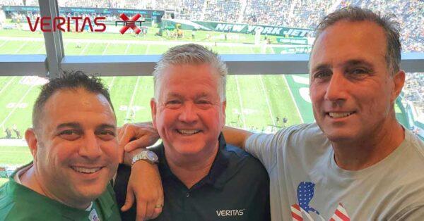 Men smiling in Skybox at football game